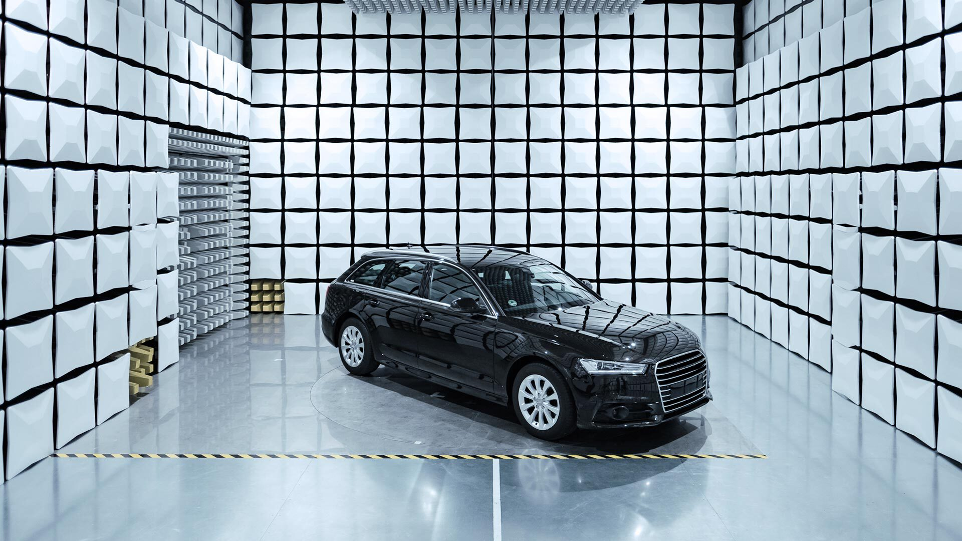 Black car inside a measuring laboratory.