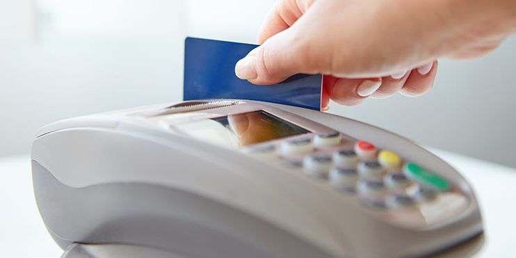 payment terminal reading a bank card