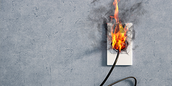 Fire and smoke at an electrical power outlet