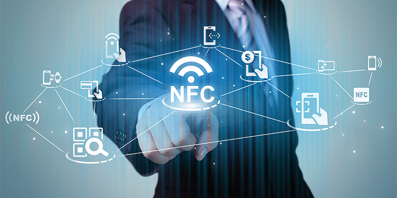 NFC technology Concept on smart phone and smart watch - Business Man touch on a touch screen interface